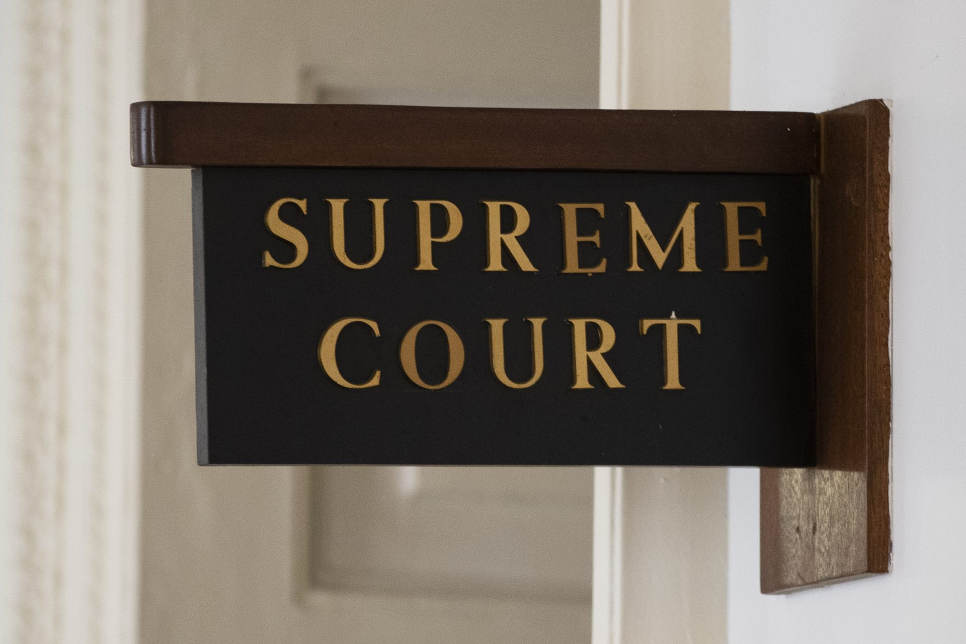 The sign for the Pennsylvania Supreme Court is posted by its door at City Hall in Philadelphia, Wednesday, Sept. 11, 2019.