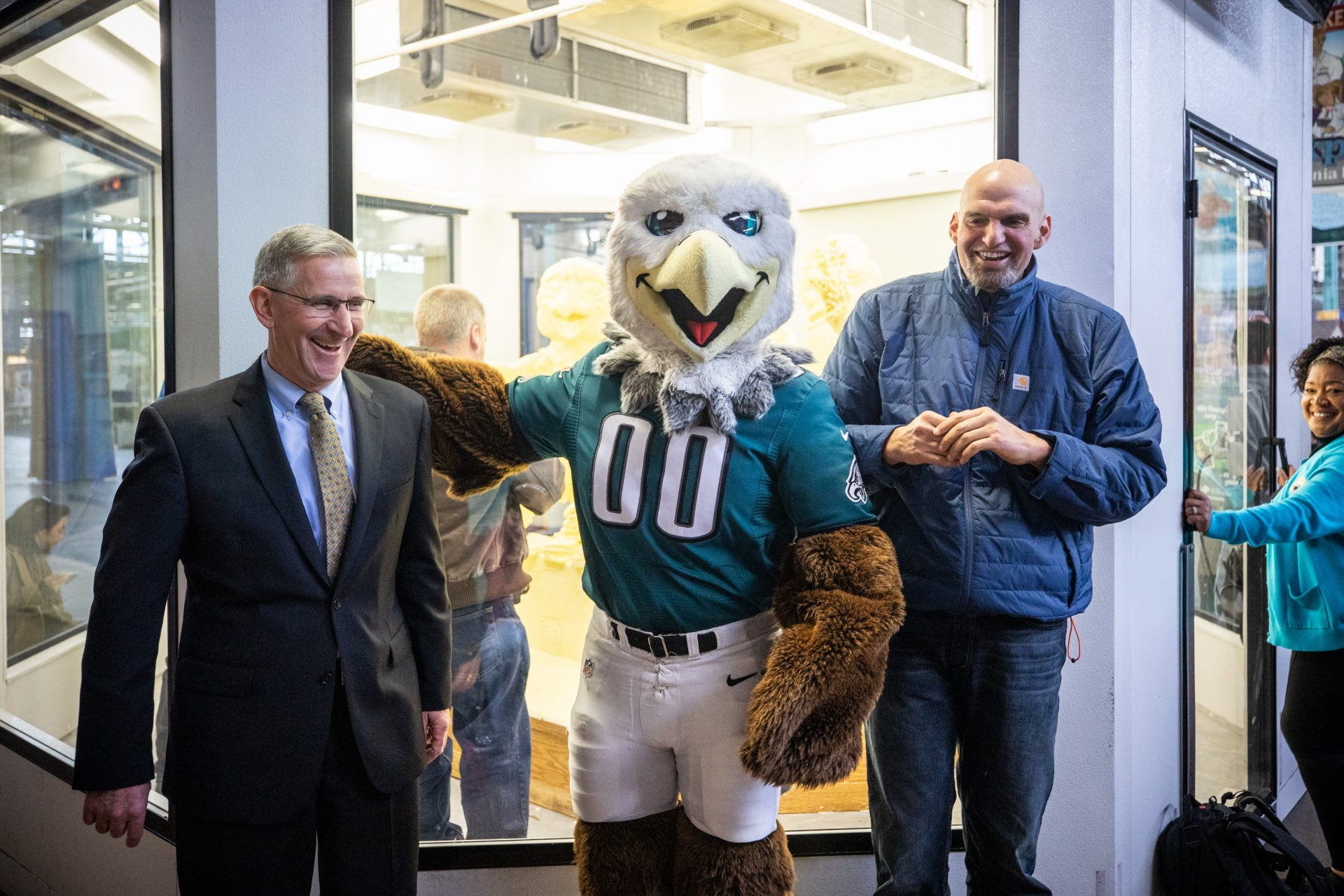 Philadelphia Eagles' Swoop poses for a photos with Secretary of Agriculture Russell Redding (left) and Lt. Gov. John Fetterman after the unveiling of the 2020 Pennsylvania Farm Show butter sculpture.