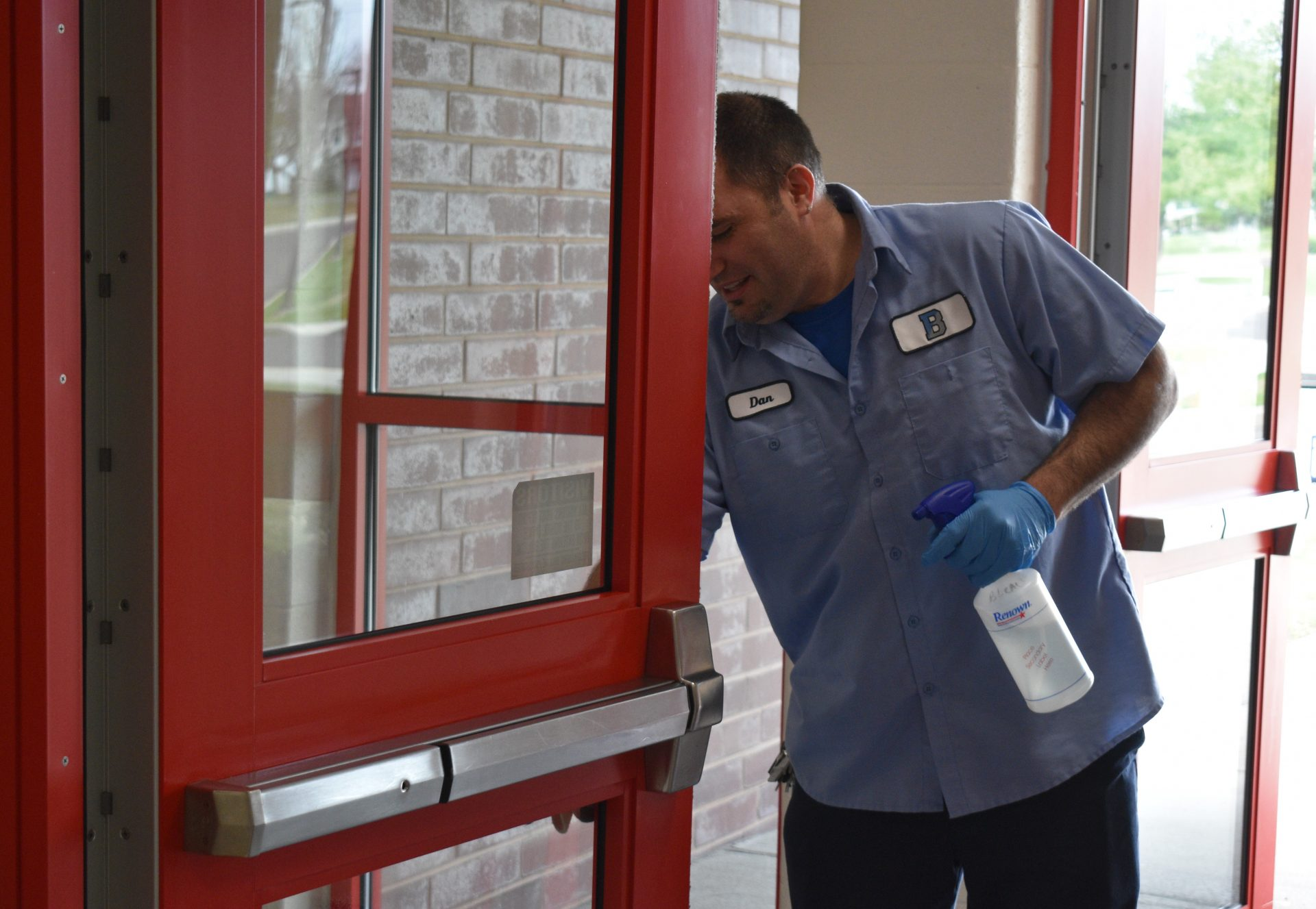 Dan Mortimer, a custodian at Cornwell Elementary School in Bensalem Township, cleans doors leading into the polling place for two precincts during Tuesday's special House district 18 election.