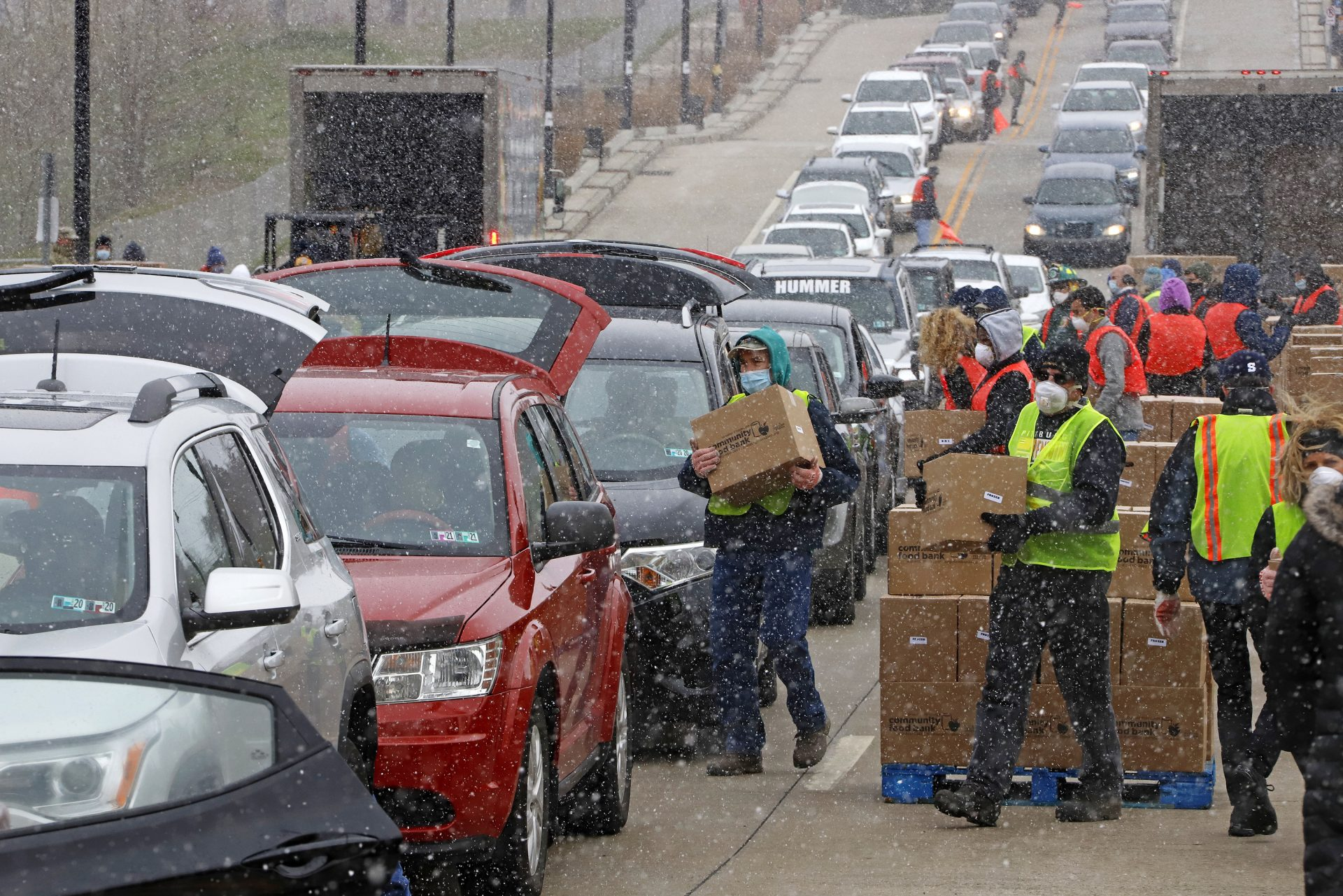 FILE PHOTO: Boxes of food are distributed by the Greater Pittsburgh Community Food Bank, at a drive thru distribution near PPG Arena in downtown Pittsburgh, Friday, April 10, 2020.