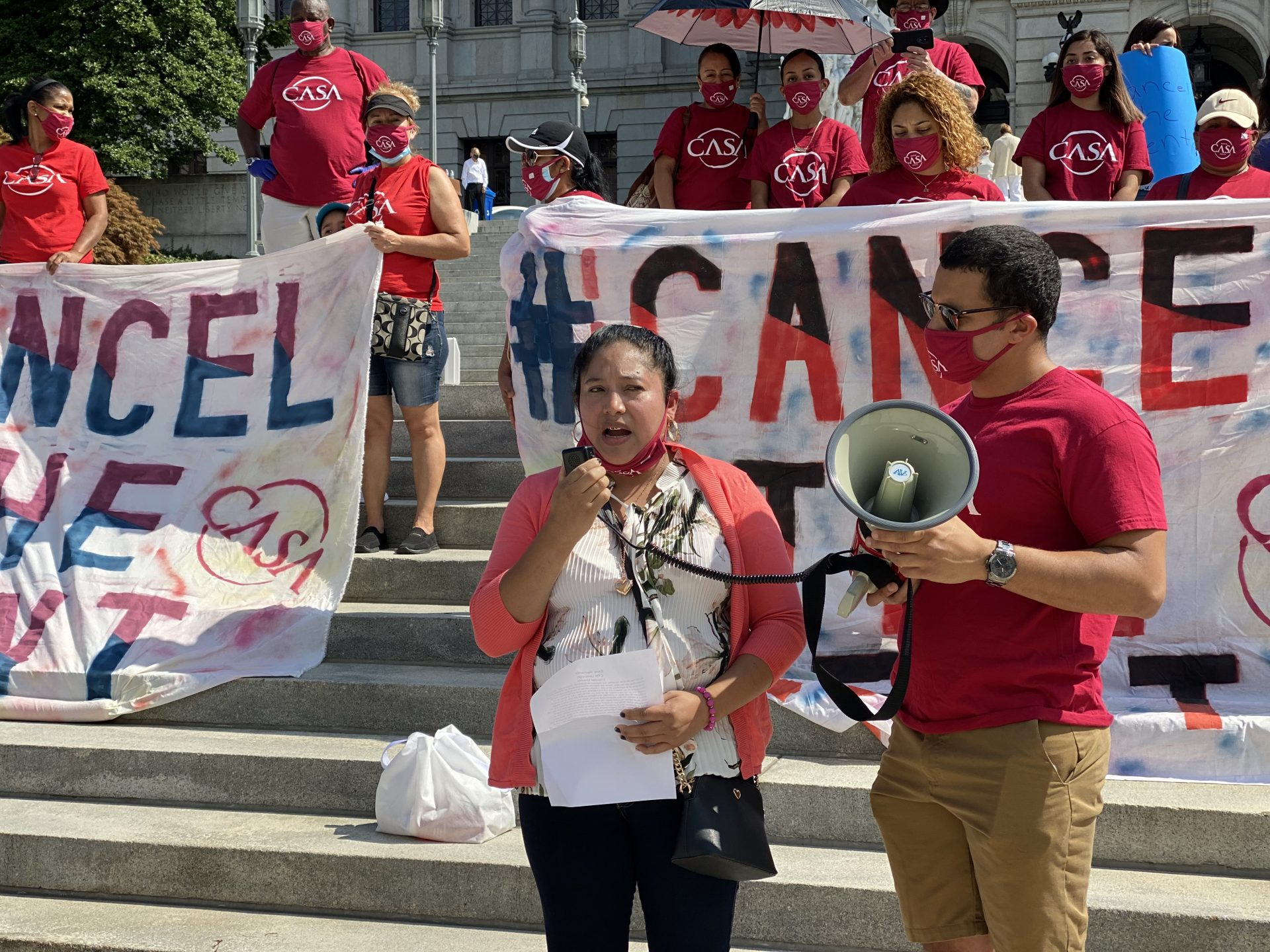 Elvia Gonzalez shared her story about losing work, contracting the coronavirus and struggling to pay rent during the pandemic Wednesday on the Capitol building steps. (Anthony Orozco/WITF)