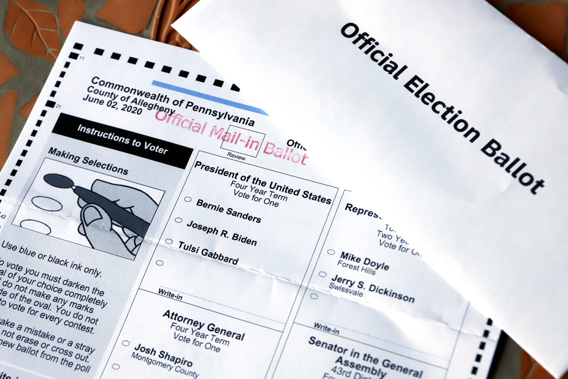 This May 26, 2020 file photo shows an Official Democratic General Primary mail-in ballot and secrecy envelope, for the Pennsylvania primary in Pittsburgh.