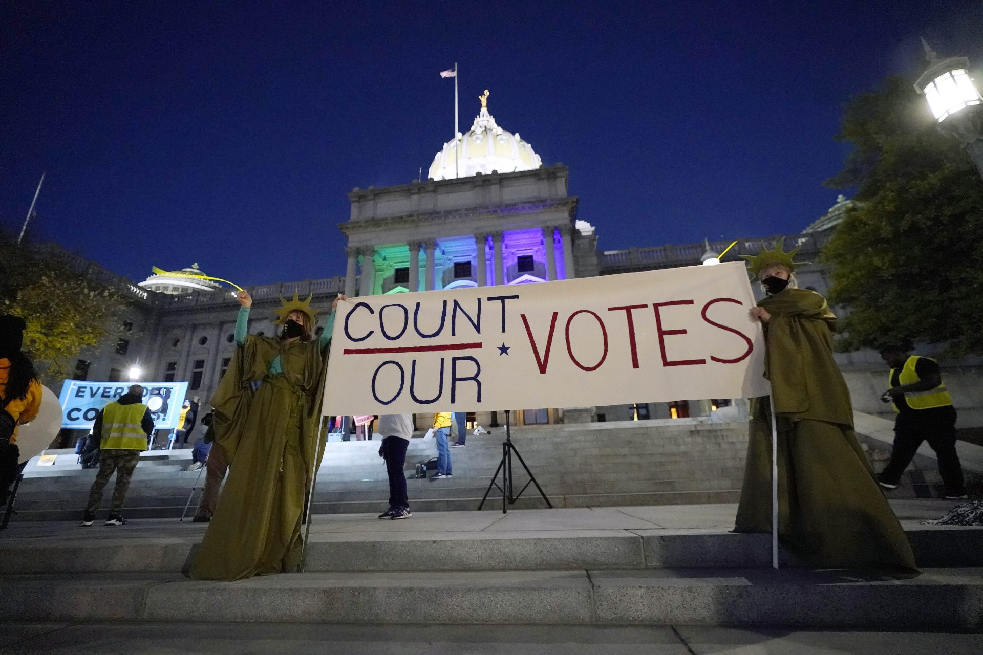 People demonstrate outside the Pennsylvania State Capitol to urge that all votes be counted, Wednesday, Nov. 4, 2020, in Harrisburg, Pa., following Tuesday's election.