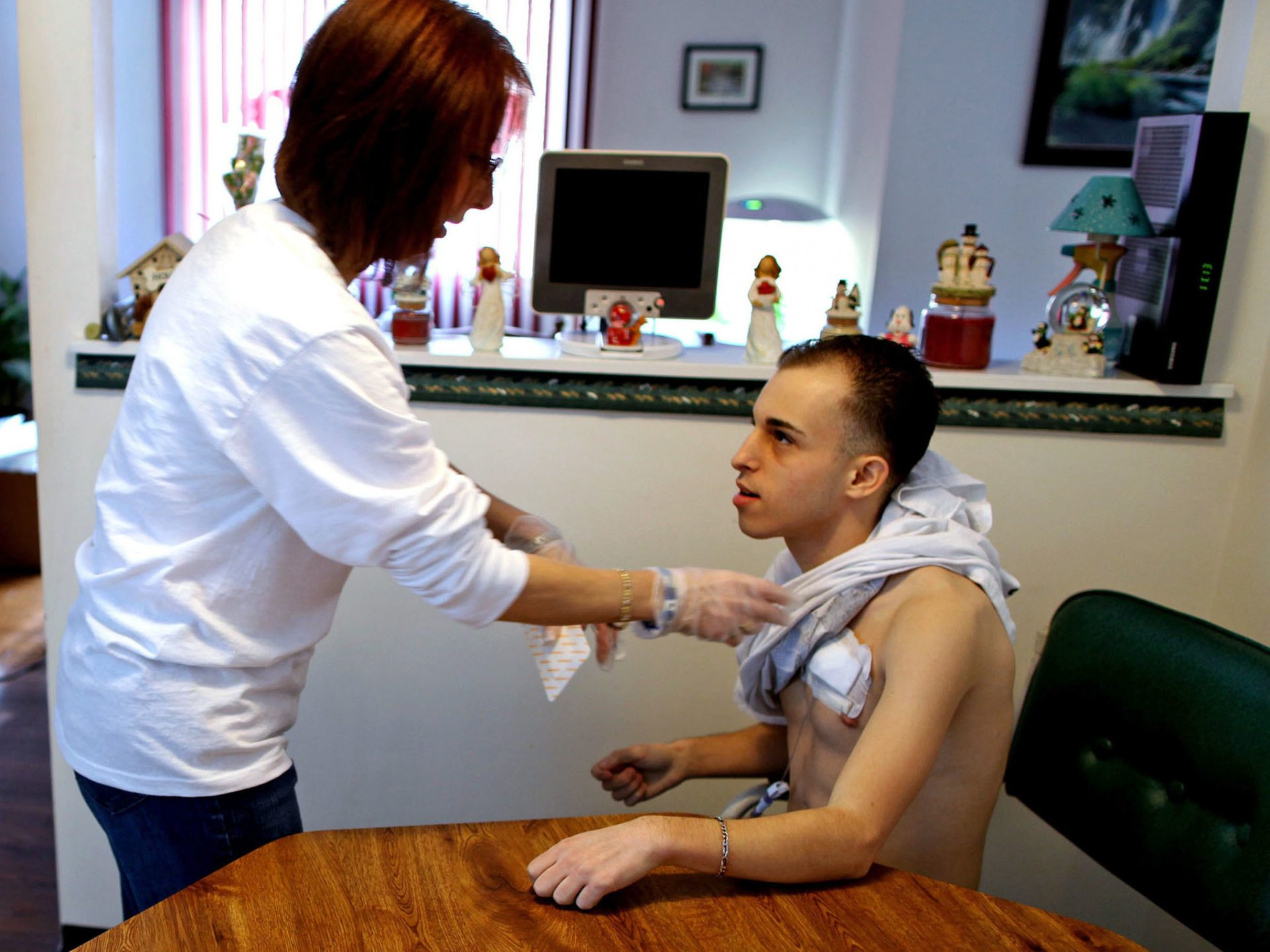 While waiting for a liver transplant in 2011, 21-year-old Matthew Rosiello (shown here getting catheter help from his mom while he was on the waitlist) was advised by his doctors to relocate from New York to Ohio — where the wait would be shorter. Indeed, in 2012 Rosiello received a liver transplant in Cleveland.