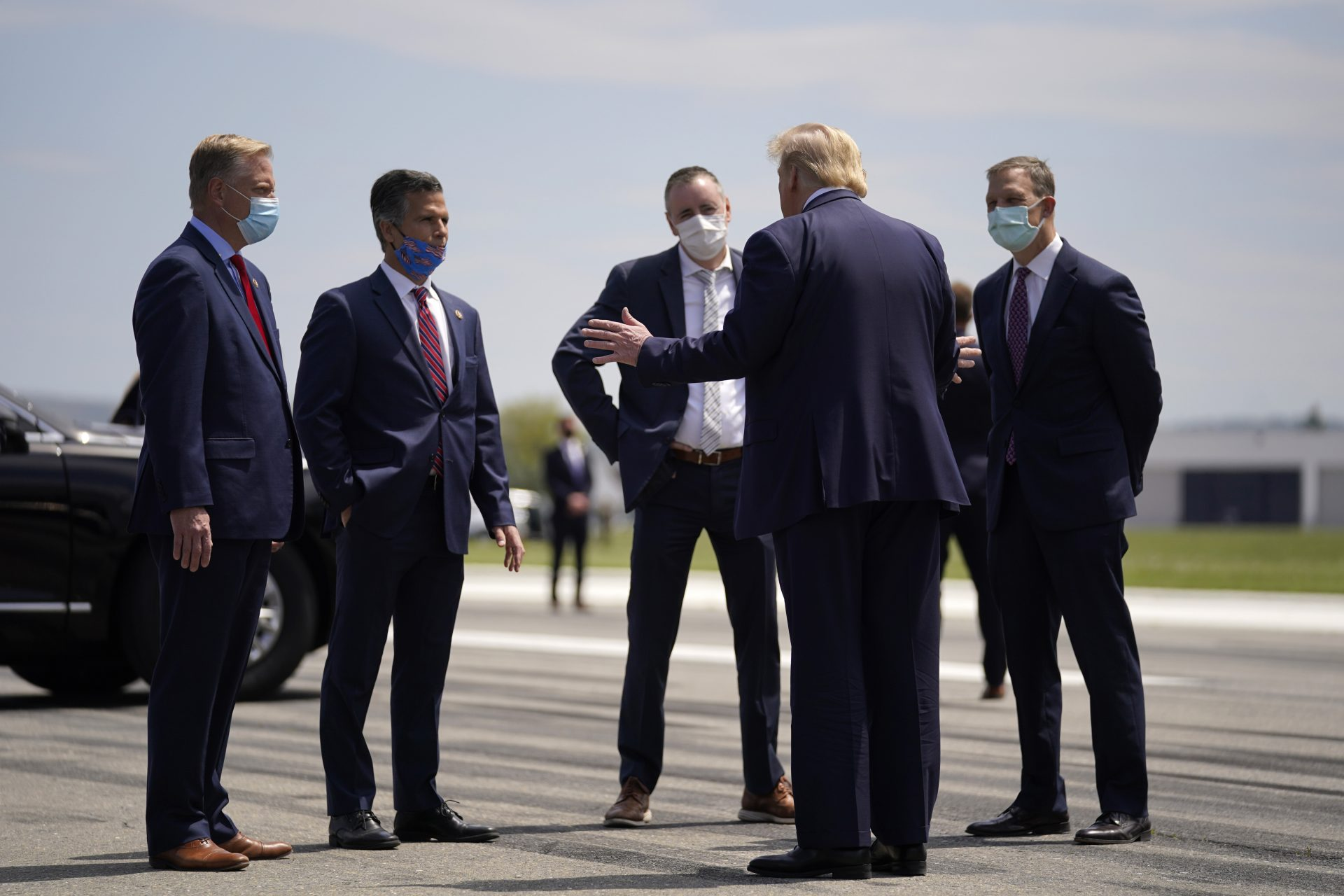 FILE PHOTO: President Donald Trump, second from right, speaks with from left, Rep. Fred Keller, Rep. Dan Meuser, Rep. Brian Fitzpatrick, Rep. Scott Perry after arriving at Lehigh Valley International Airport in Allentown, Pa., Thursday, May 14, 2020.