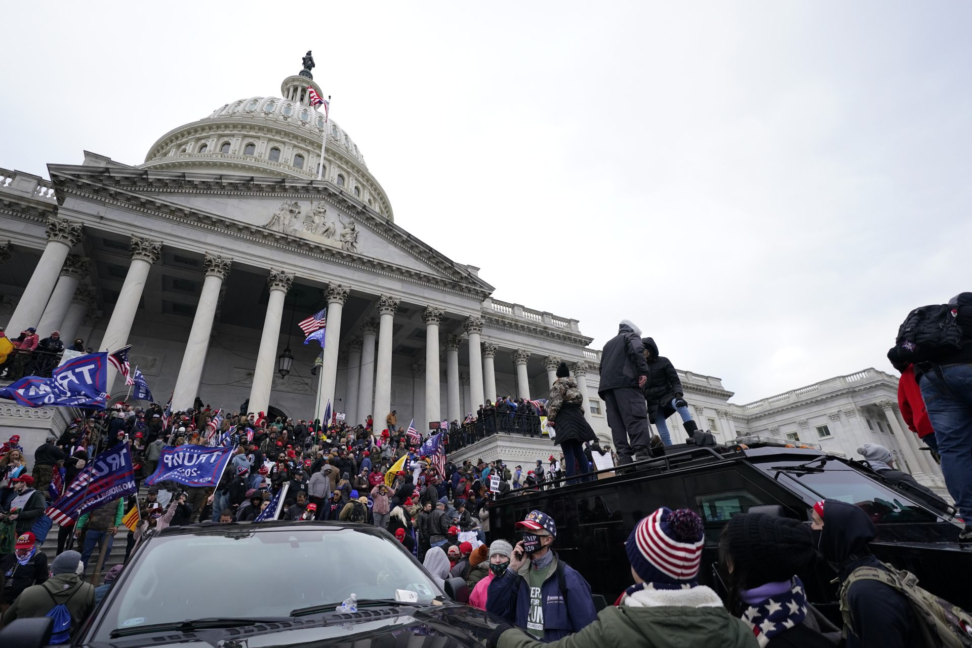 Trump supporters stand on top of a police vehicle, Wednesday, Jan. 6, 2021, at the Capitol in Washington. As Congress prepares to affirm President-elect Joe Biden's victory, thousands of people have gathered to show their support for President Donald Trump and his claims of election fraud.