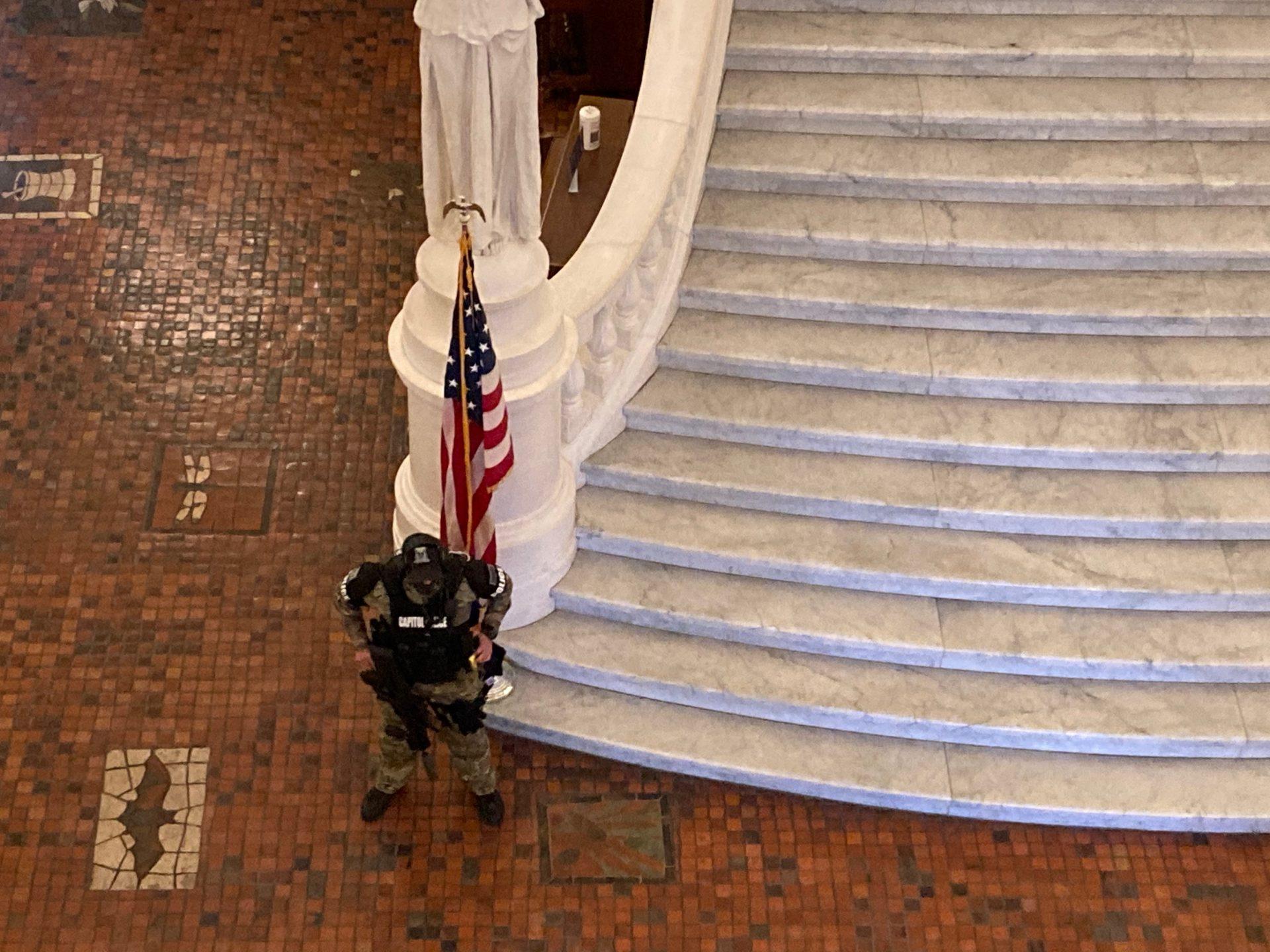 An armed Pennsylvania Capitol Police officer guards the rotunda at the Pennsylvania Capitol on Jan. 12, 2021.