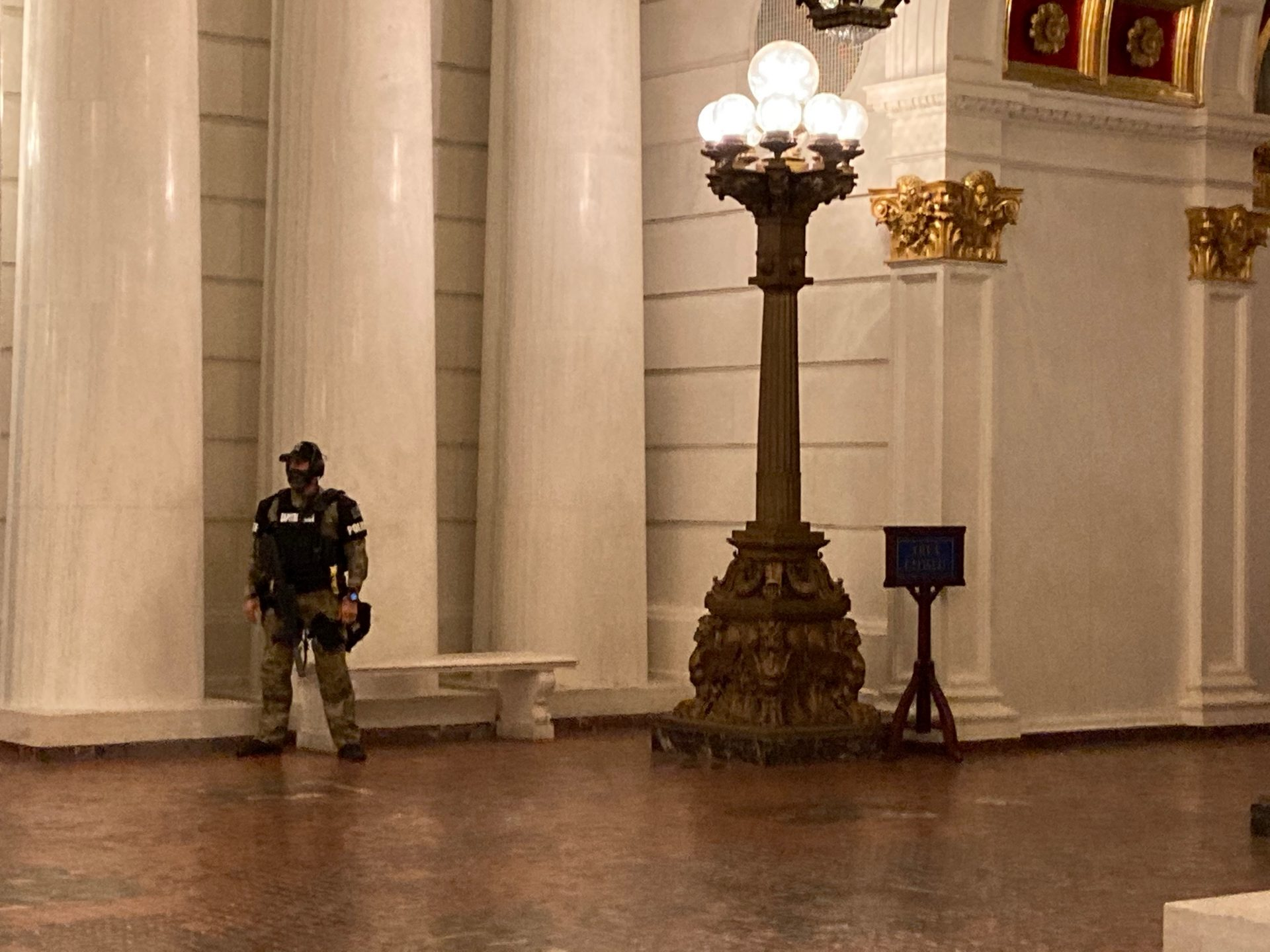 An armed Pennsylvania Capitol Police officer guards the building on Jan. 12, 2021.
