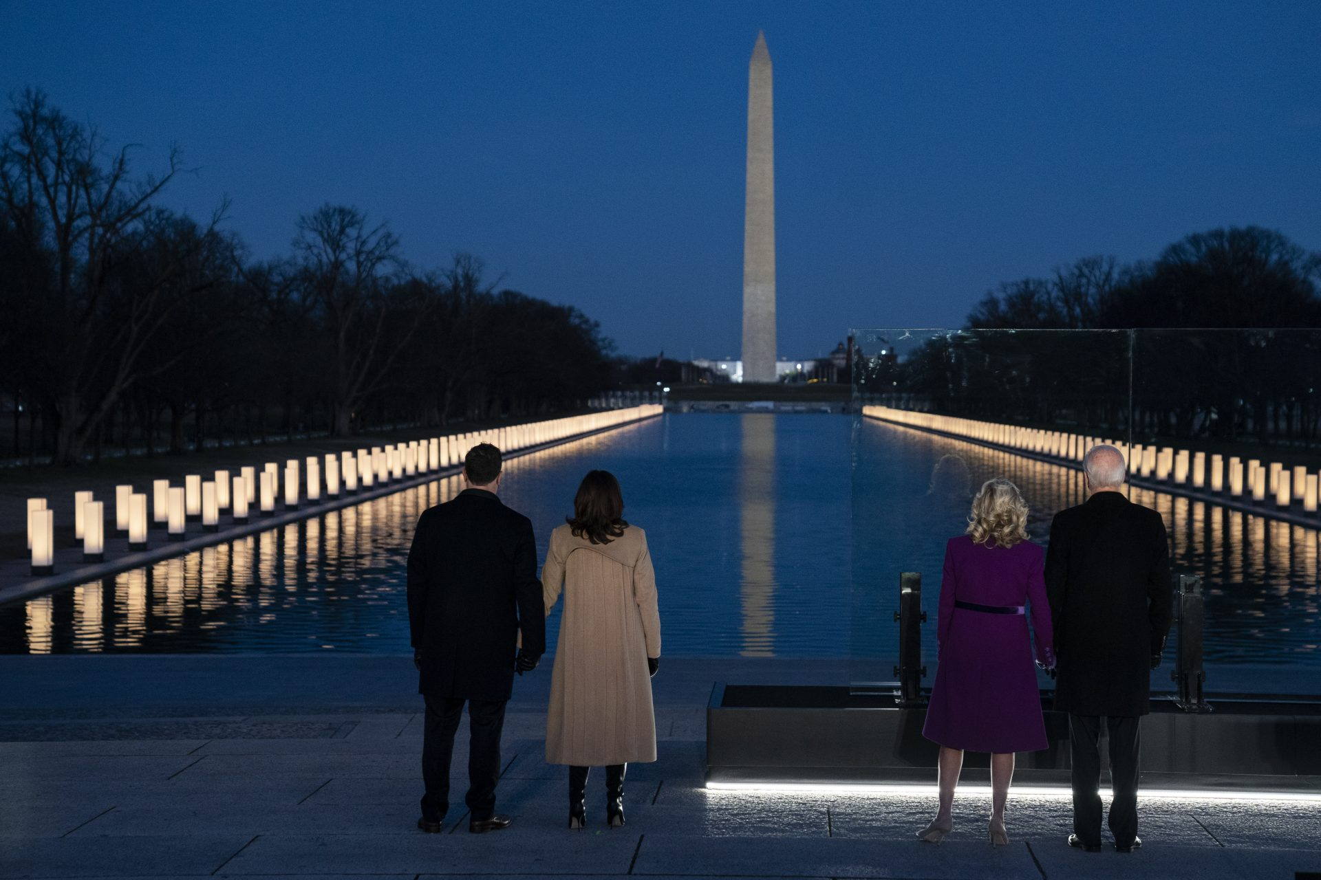 President-elect Joe Biden and his wife Jill Biden are joined by Vice President-elect Kamala Harris and her husband Doug Emhoff to participate in a COVID-19 memorial event at the Lincoln Memorial Reflecting Pool, Tuesday, Jan. 19, 2021, in Washington.