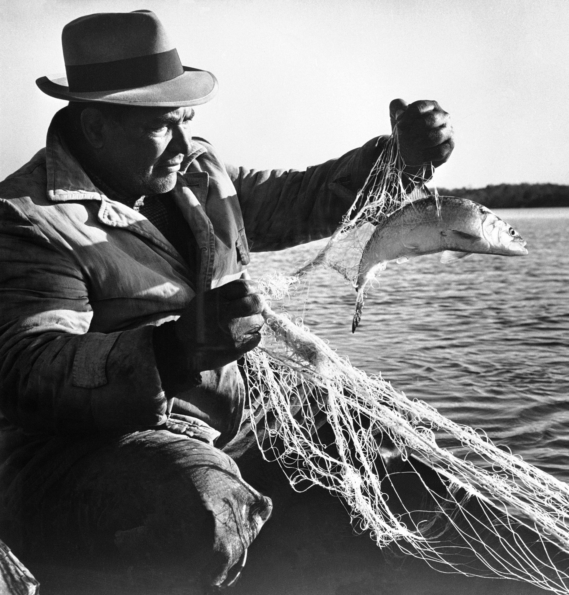FILE PHOTO: In fishing clothes, Chief of O.T. Custalow brings up a shad in his net on the Mattaponi Indian reservation in Tidewater Virginia, July 25, 1961.