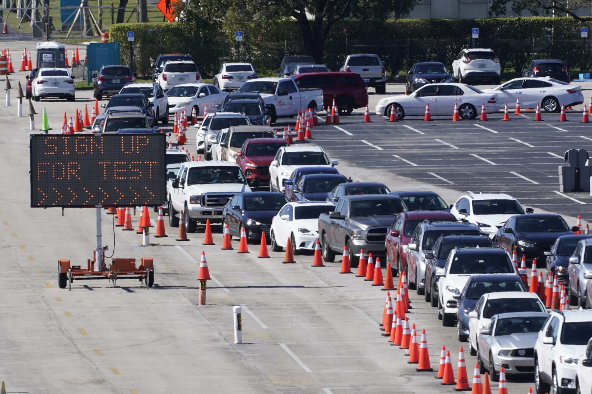 In this Jan. 5, 2021, file photo, cars line up for COVID-19 testing outside Hard Rock Stadium in Miami Gardens, Fla. Coronavirus hospitalizations are falling across the United States, but deaths have remained stubbornly high.