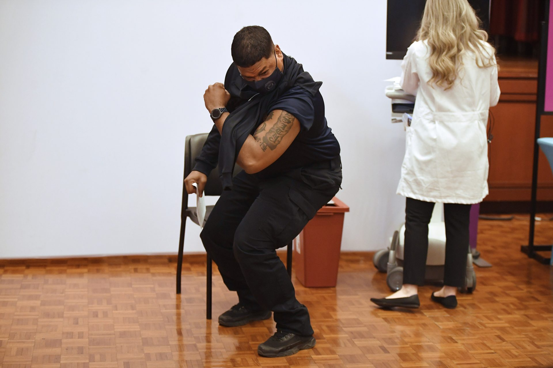 Hartford Public Schools Safety Officer Victor Rodriguez flexes his arm muscle after receiving a Johnson & Johnson COVID-19 at Hartford Hospital in Hartford, Conn., Wednesday, March 3, 2021.