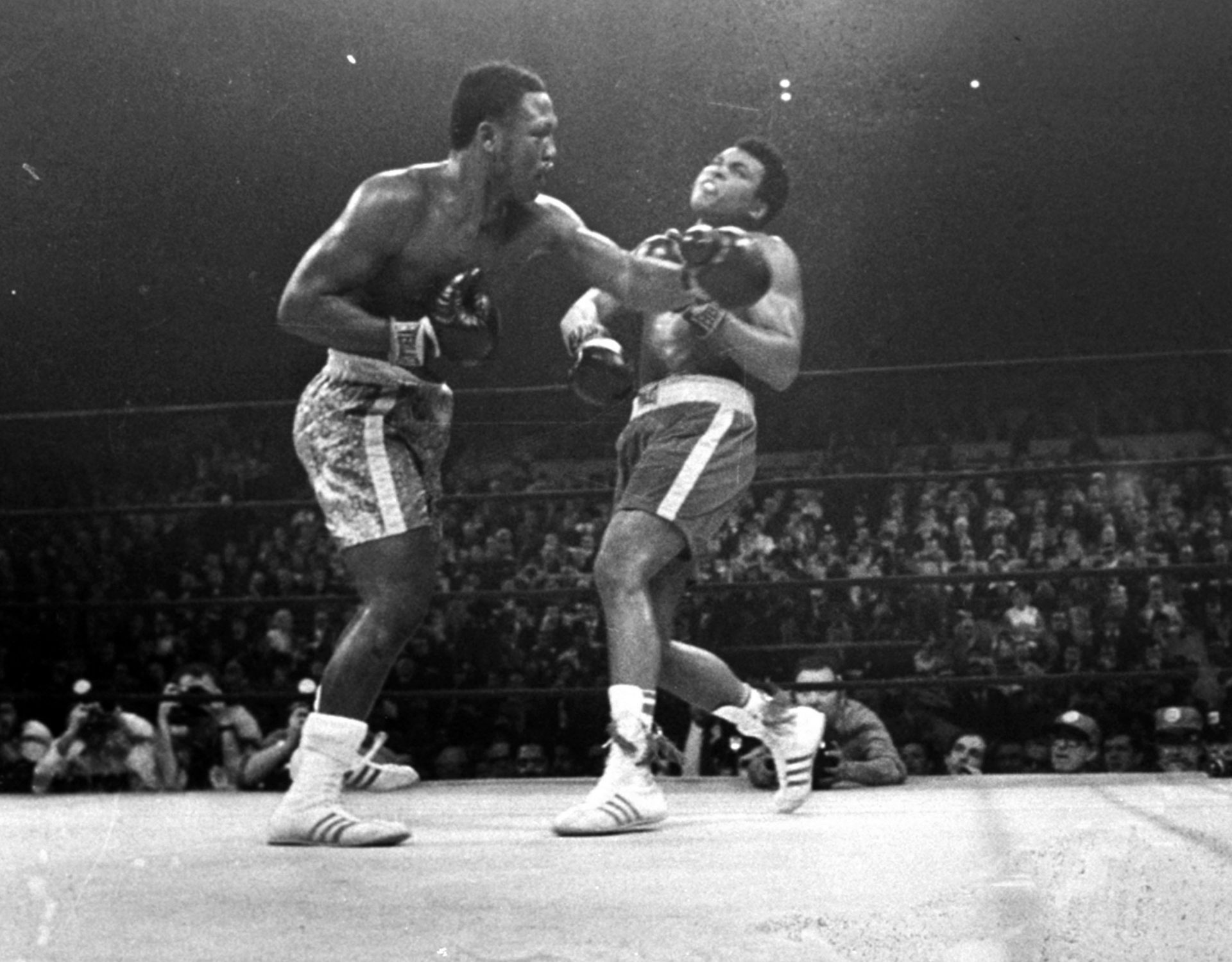 FILE PHOTO: In this March 8, 1971, file photo, boxer Joe Frazier, left, hits Muhammad Ali during the 15th round of their heavyweight title fight at New York's Madison Square Garden.