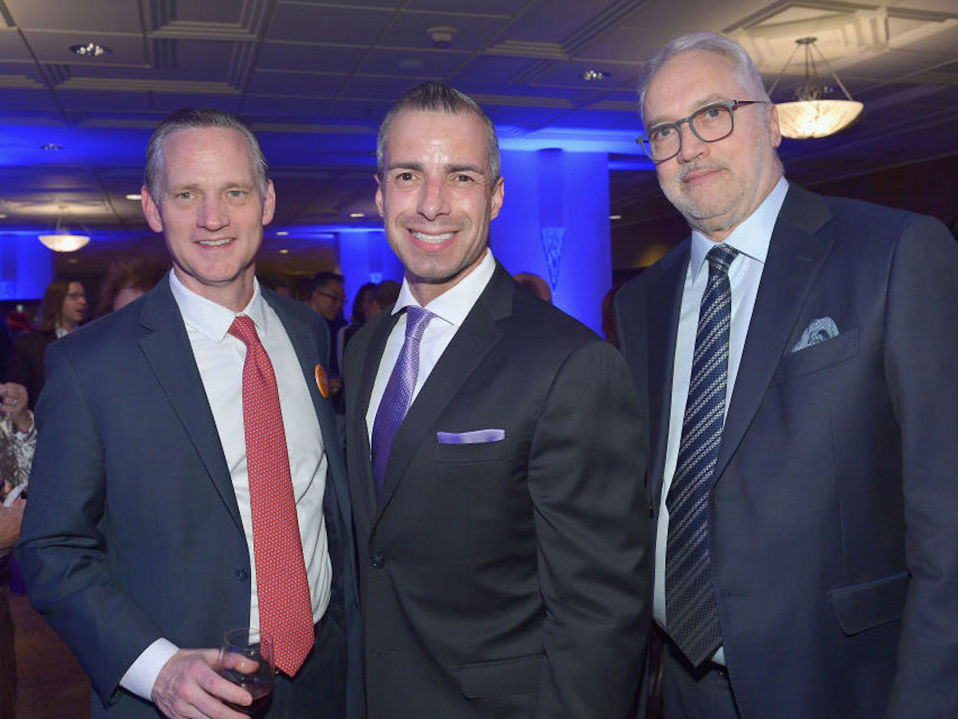 A Martinez (center) has been named a new co-host for NPR's Morning Edition. He is shown with Southern California Public Radio CEO Herb Scannell (right) at a fundraising gala for KPCC in March 2019.