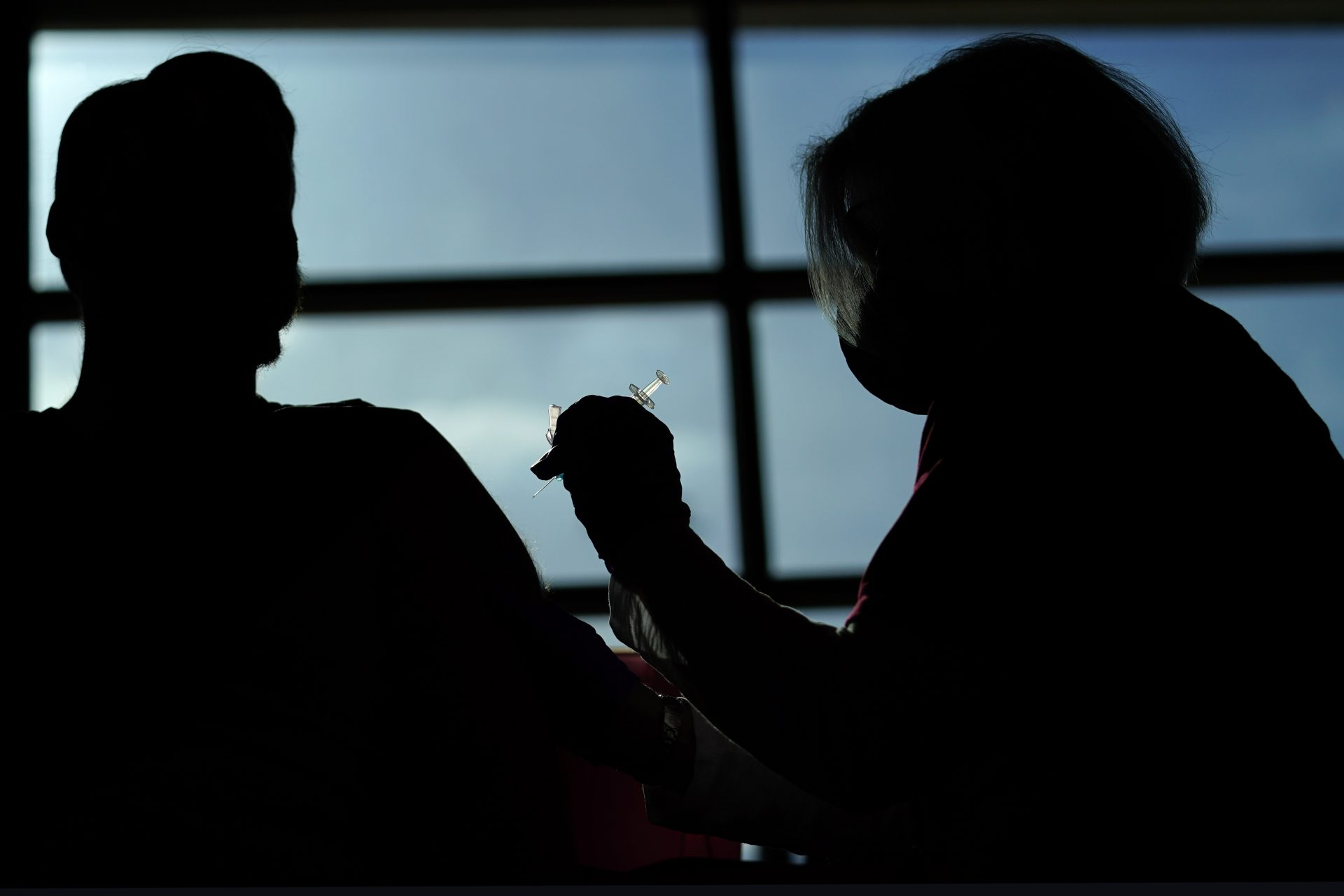 Philadelphia Flyers ice crew member Ryan DiFilipo, left, receives a Johnson & Johnson COVID-19 vaccination from nurse practitioner Erin McMenamin at the Wells Fargo Center before an NHL hockey game against the New Jersey Devils, Monday, May 10, 2021, in Philadelphia.