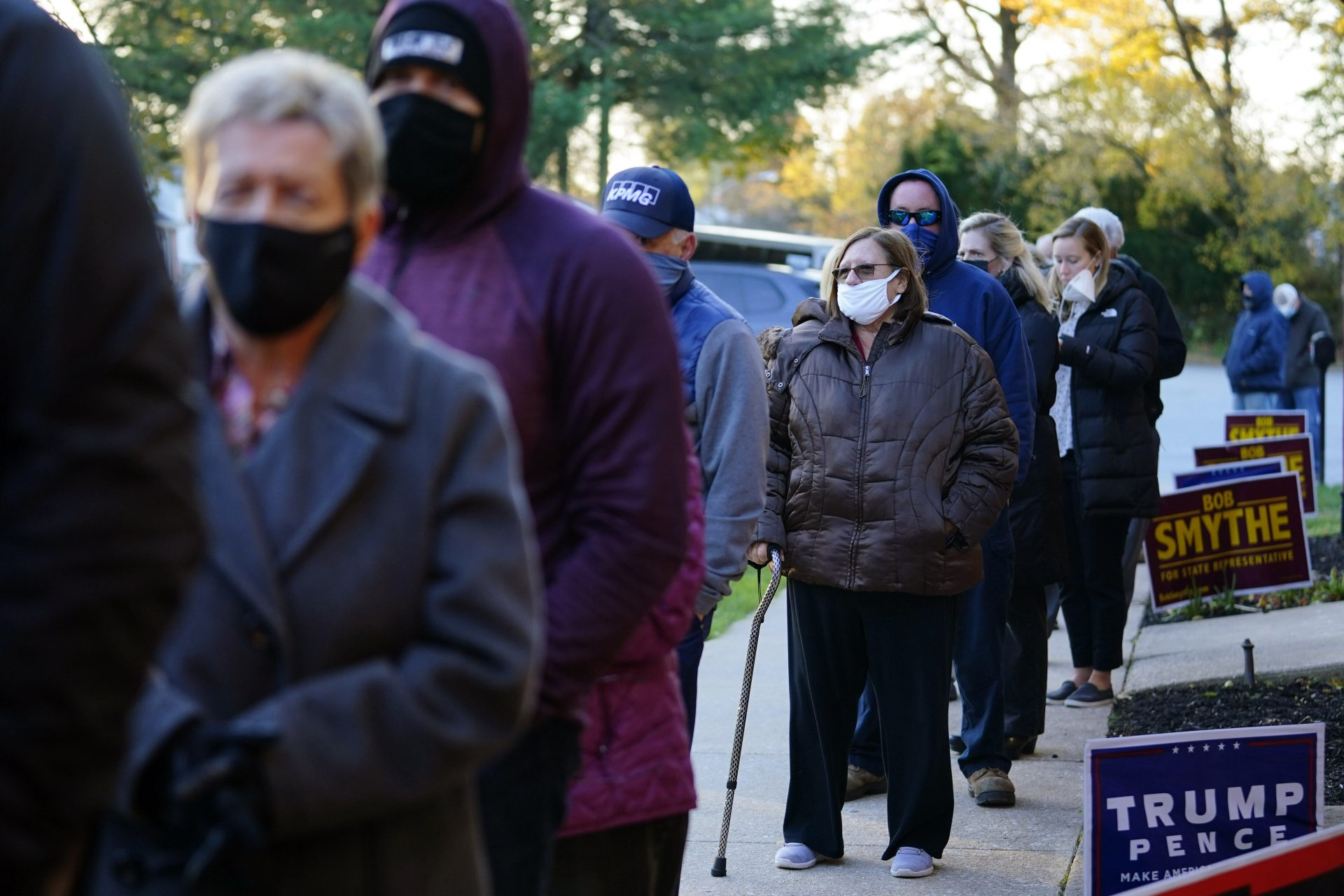In this Nov. 3, 2020, file photo, people line up outside a polling place in Springfield, Pa. to vote in the 2020 general election.
